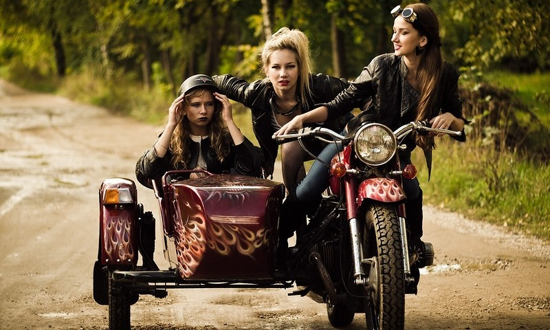 3 girls on a Dnipro motorcycle
