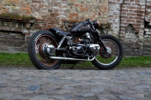 a nice custom cafe-racer near a brick wall