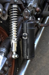 a small bag with tools on a custom bike