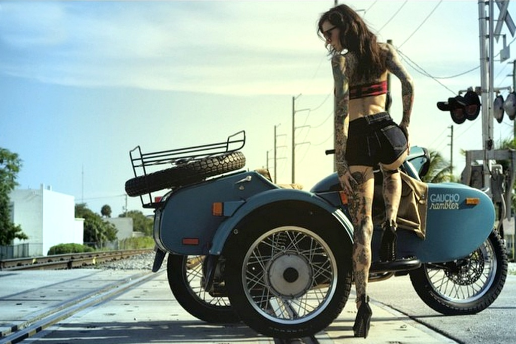a hot girl next to a motorcycle with a sidecar