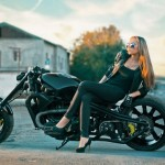 a beautiful girl sitting on a custom Dnipro motorcycle