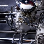 an automobile carburetor installed on an M72 engine