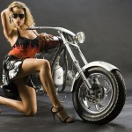 a hot chick near a custom chopper M72