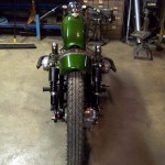 a custom Ural motorcycle in a garage