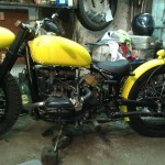 the assembled custom bobber parked in a garage