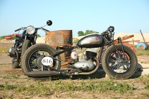 a custom Jawa bobber motorcycle next to a Dnipro MT
