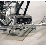a set of custom foot pegs and levers installed on a custom Ural chopper