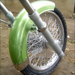 the front wheel of this custom chopper made from an Izh motorcycle