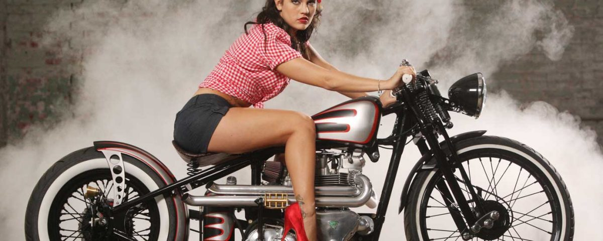 an old-fashioned girl on a vintage motorcycle