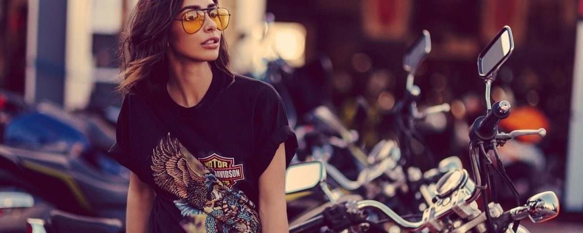 a hot girl with sunglasses sitting on a motorcycle